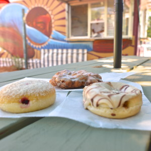 Raspberry Filled, Apple Fritter and an Austin Cream Pie donut from Red Rabbit Bakery