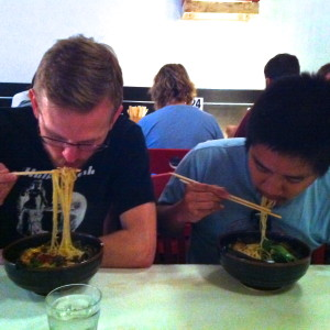 Ross and I dig into bowls of hot ramen.