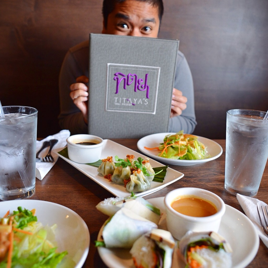 Dan displays the new menu at Titaya's Thai