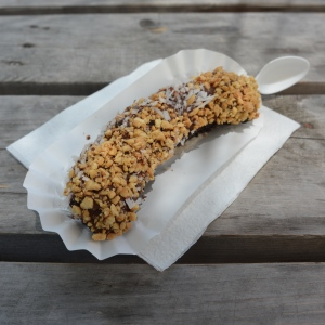 Whole banana, dipped in vegan chocolate, with nuts and coconut from Bananarchy