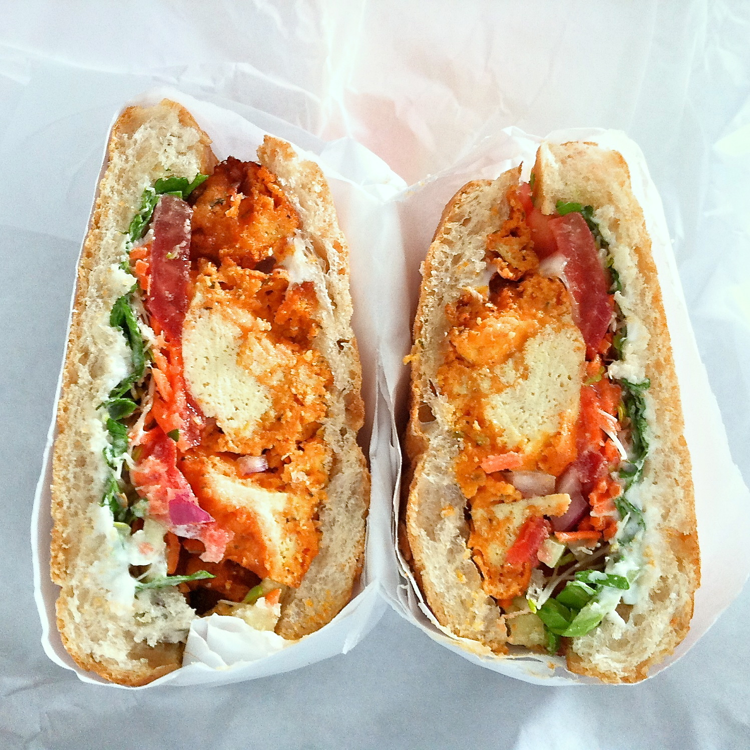 Buffalo Popcorn Tofu on Ciabatta from Wheatsville Coop